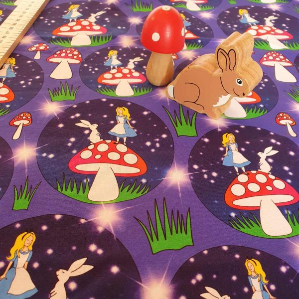 Alice and the rabbit standing on a mushroom