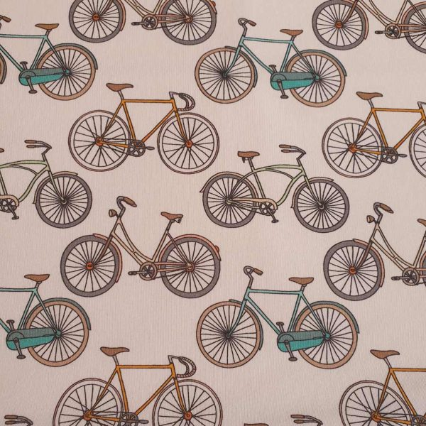 Tan, mint and yellow bicycles on white French Terry fabric