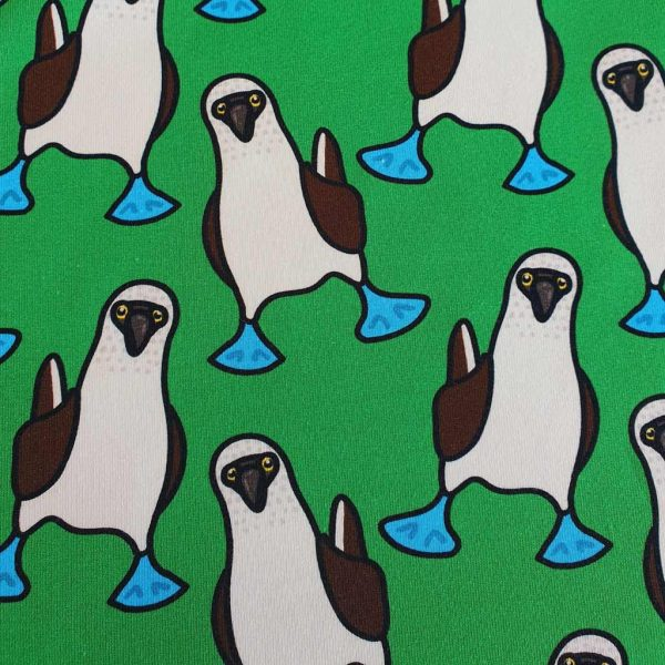 Blue-footed Boobies birds on green jersey fabric