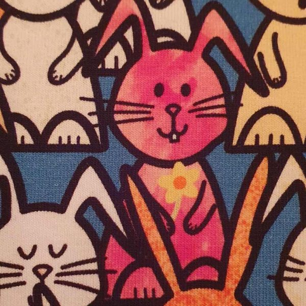 Multi-coloured rabbits on blue jersey fabric