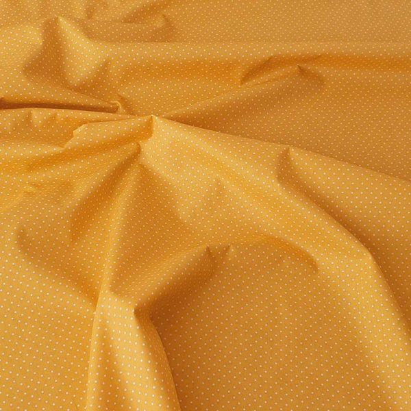 Citrine yellow fabric with white spots