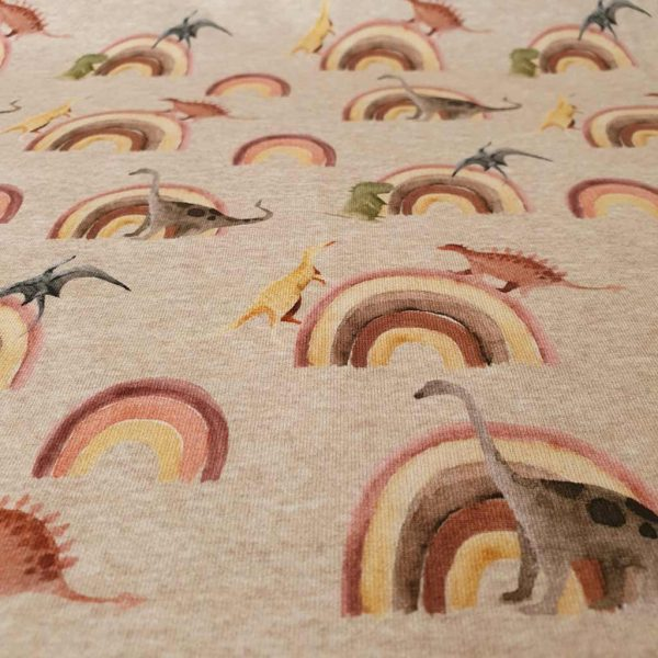 Dinosaurs with rainbows on jersey fabric