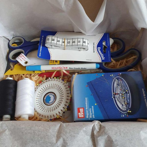 Sewing kit with scissors, thread, tape measure and pins