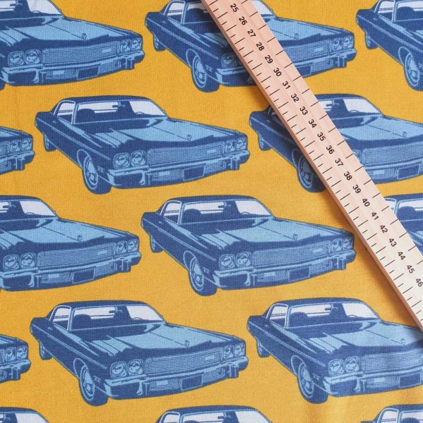 Blue car on yellow fleece French Terry fabric