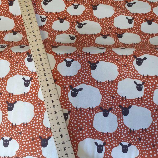 Flock of sheep burnt orange jersey fabric