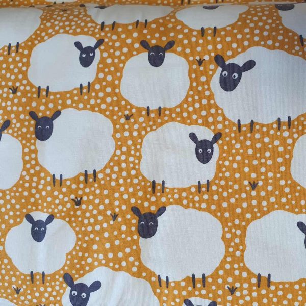 Flock of Sheep in mustard coloured jersey fabric