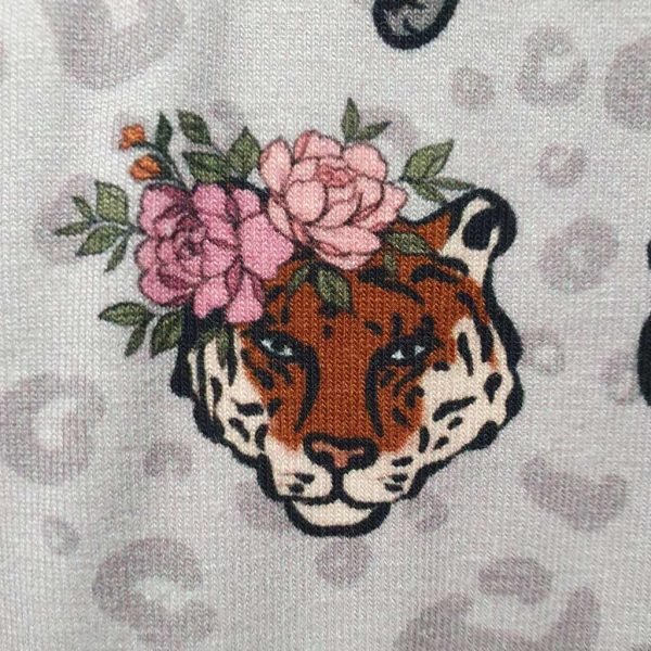 Jungle animals wearing flowering crowns on cotton jersey fabric