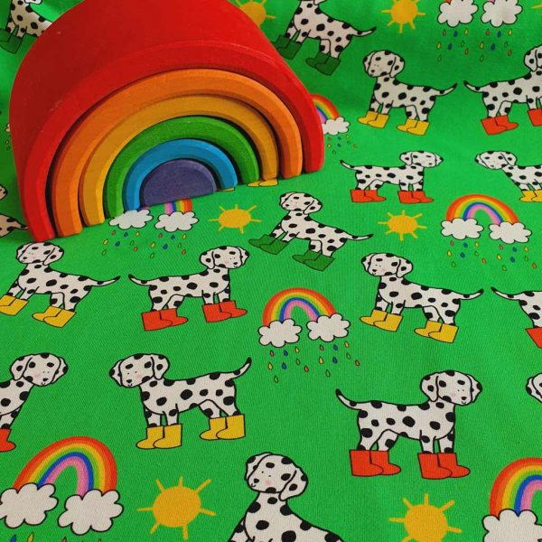 Dalmatians and rainbows on a green background