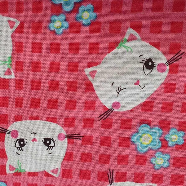 Cats on pink cotton fabric