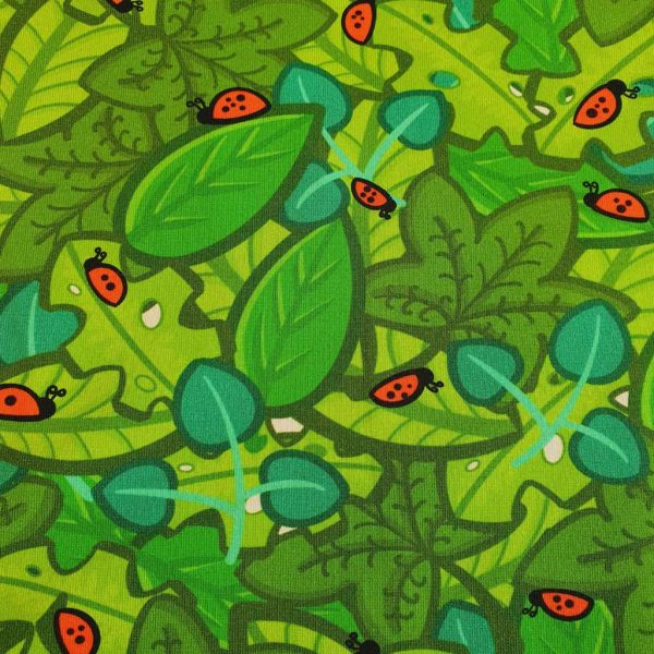 Green leaves and ladybirds cotton jersey fabric