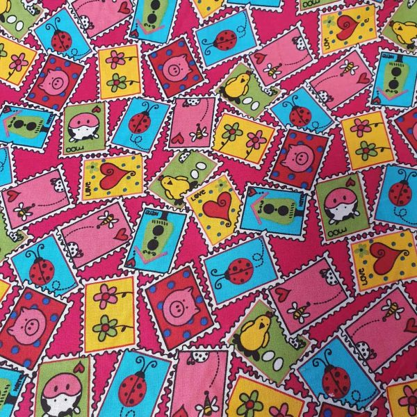 Colourful stamps fabric with a pink background