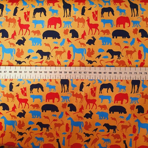 Red and blue animals on orange jersey fabric