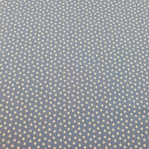 White mini hearts on blue cotton poplin fabric
