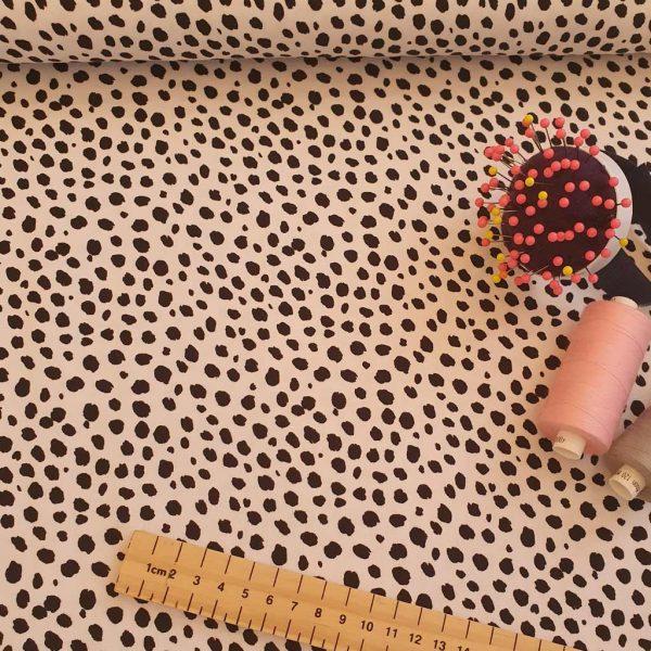 Black spots on white jersey fabric