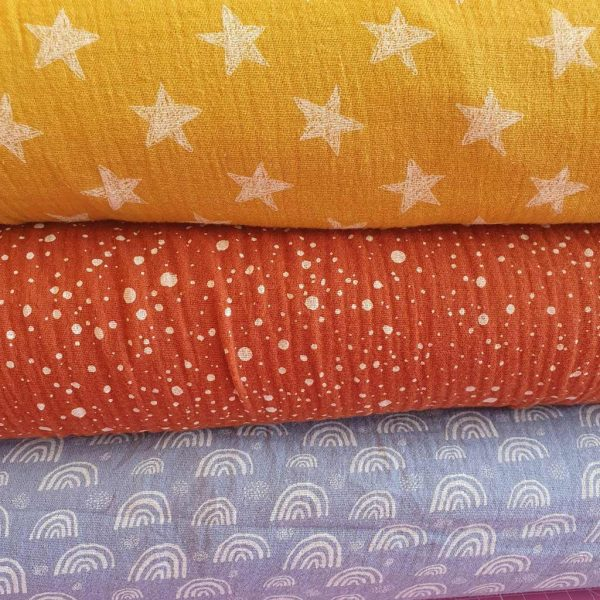 Double gauze fabric in yellow, brown and blue