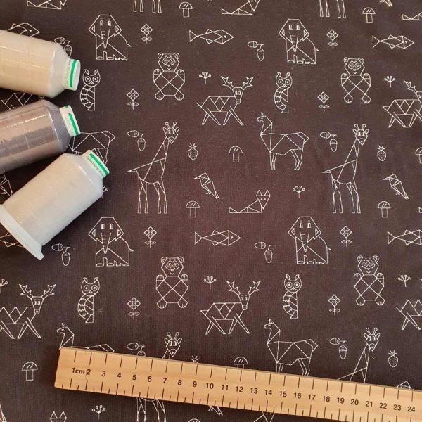 Black geometric animals on jersey fabric