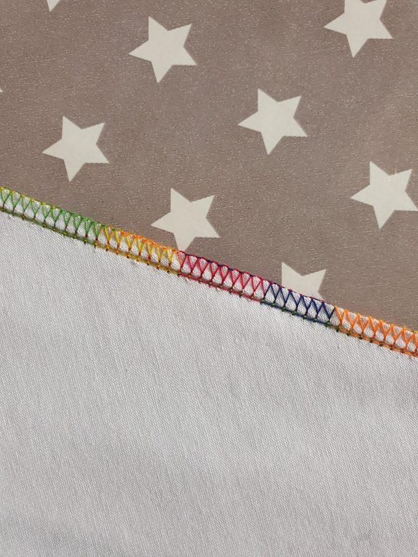 Rainbow overlocker thread stitching on fabric