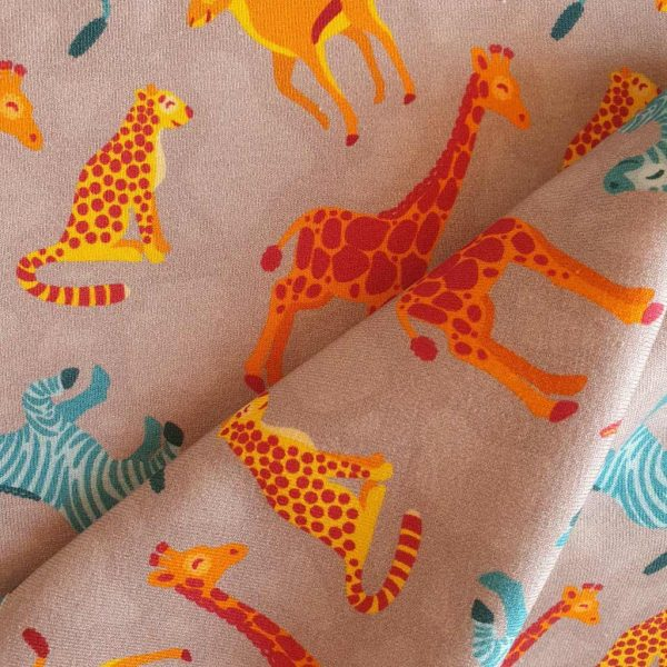 Jungle animals in orange and blue on taupe jersey fabric