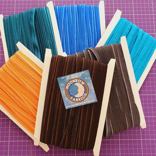 Stretch piping in grey, brown, blue, amber and teal