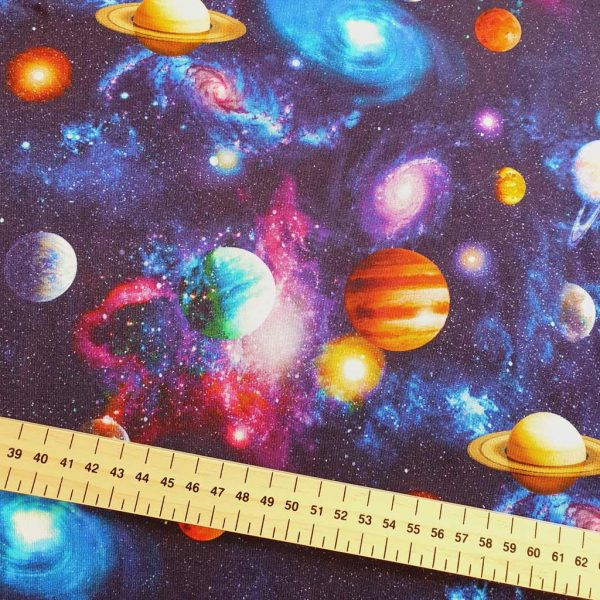 Blue jersey fabric with planets in space