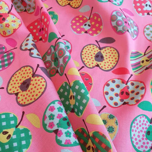 Mid-pink cotton fabric with prints Scandi-style apples