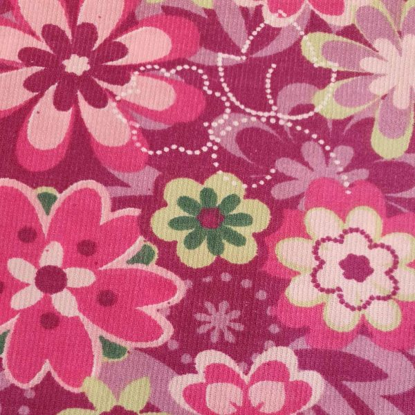 Graphic floral corduroy fabric in pinks, purples and greens