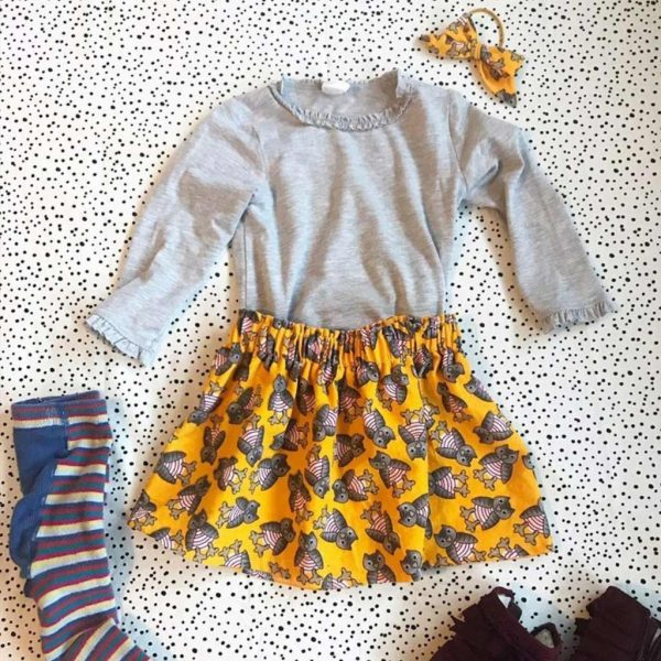 A yellow owls corduroy skirt and hairband