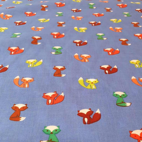 Blue cotton fabric with brown, green, orange and yellow foxes