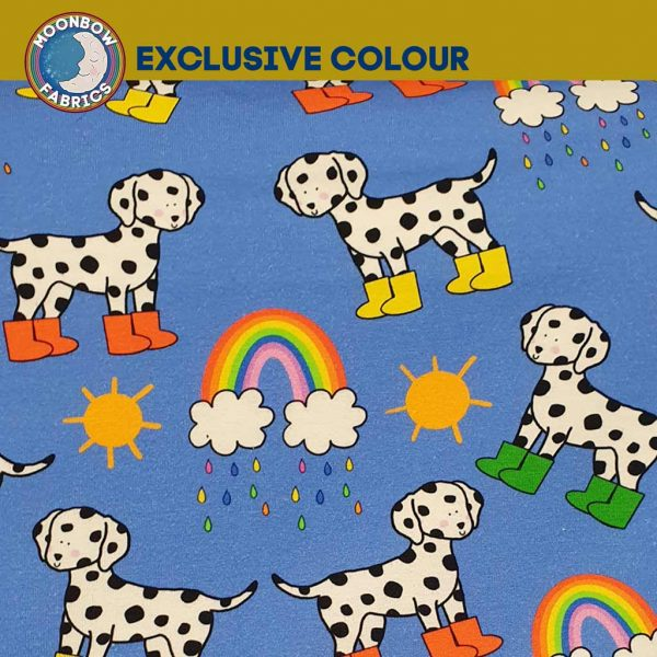 Dalmatians in mud boots on blue cotton jersey fabric