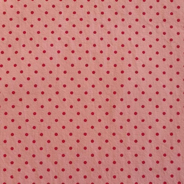 Washed cotton fabric in light pink with dark pink spots