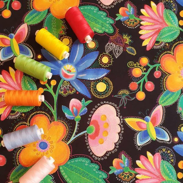 Black cotton fabric with bright printed flowers in green, orange, red, pink, blue and yellow