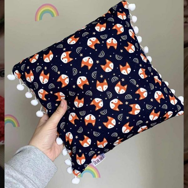 Blue cushion with foxes fabric