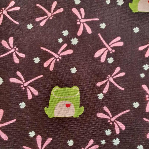 Black cotton fabric with a frog and dragongfly print