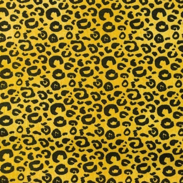 Ochre coloured jersey fabric with black leopard prints