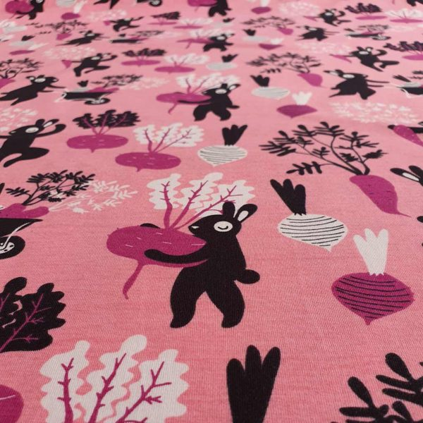 Black rabbits gardening for raddishes on a pink background jersey fabric