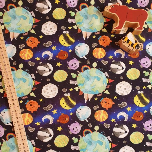 Black space fabric with printed earth, stars, animal planets and moons