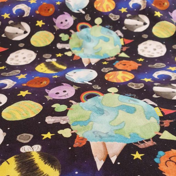 Space themed jersey fabric with printed planets and animals