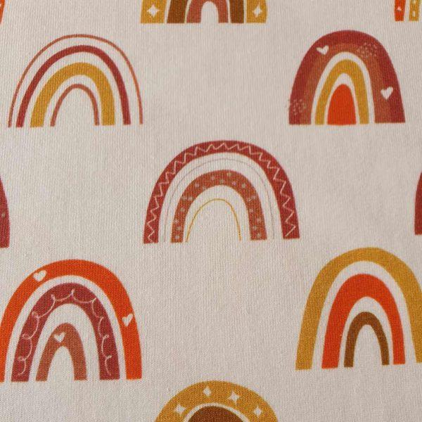 Orange rainbow arches on a cream jersey fabric