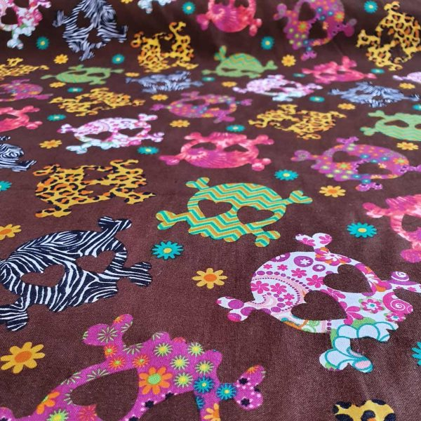 Brown cotton fabric with bold printed skulls