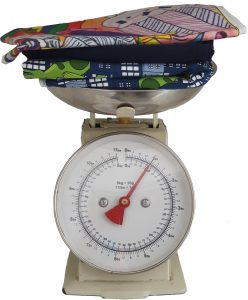 A bundle of fabrics on top of a weighing scales